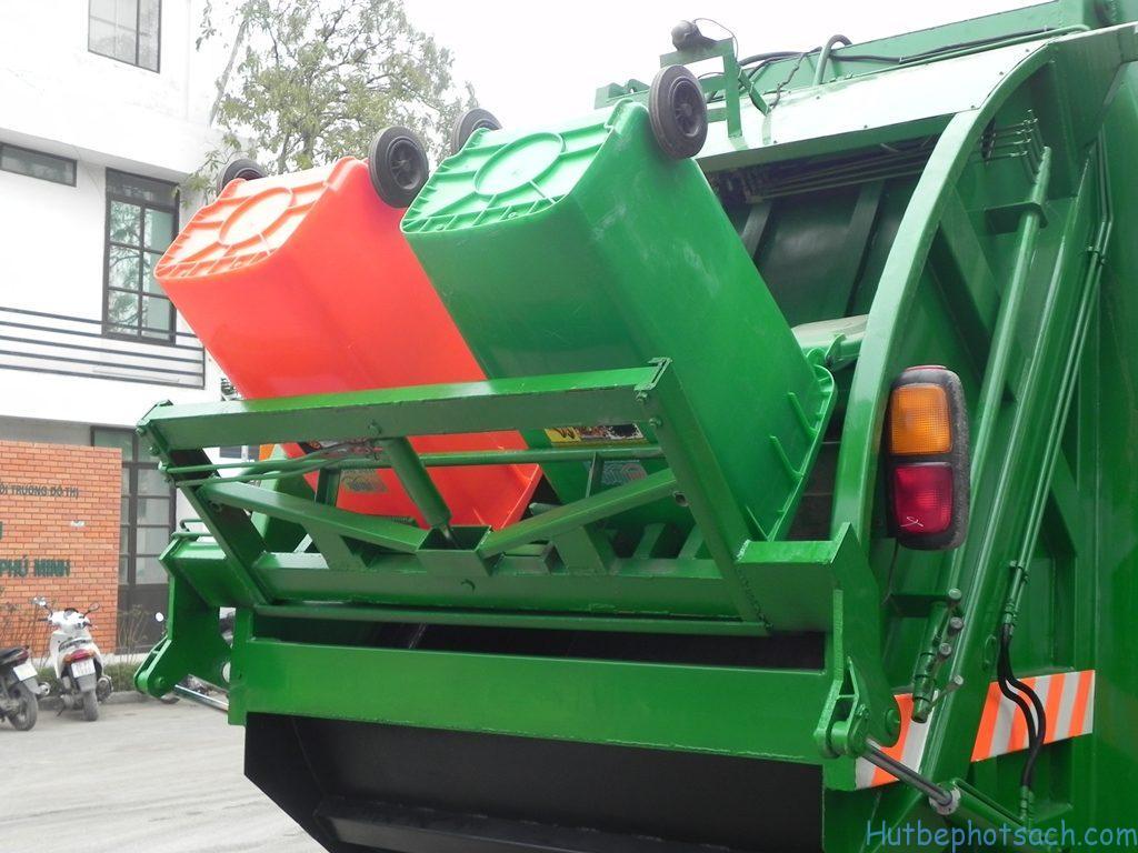 Cơ cấu nâng thùng rác và cuốn ép rác vào thùng xe